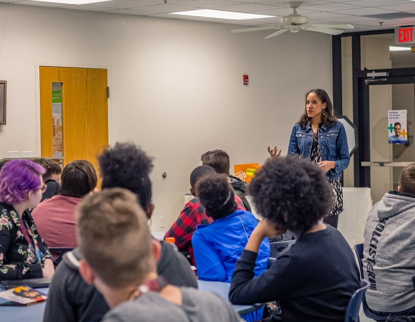 Amazonian Jenna Powers meets with high school students to talk about STEM education.