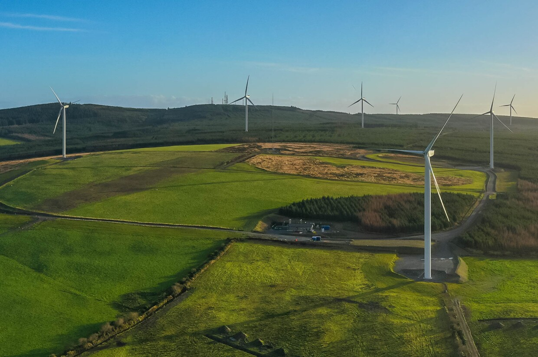 wind farm and green hills