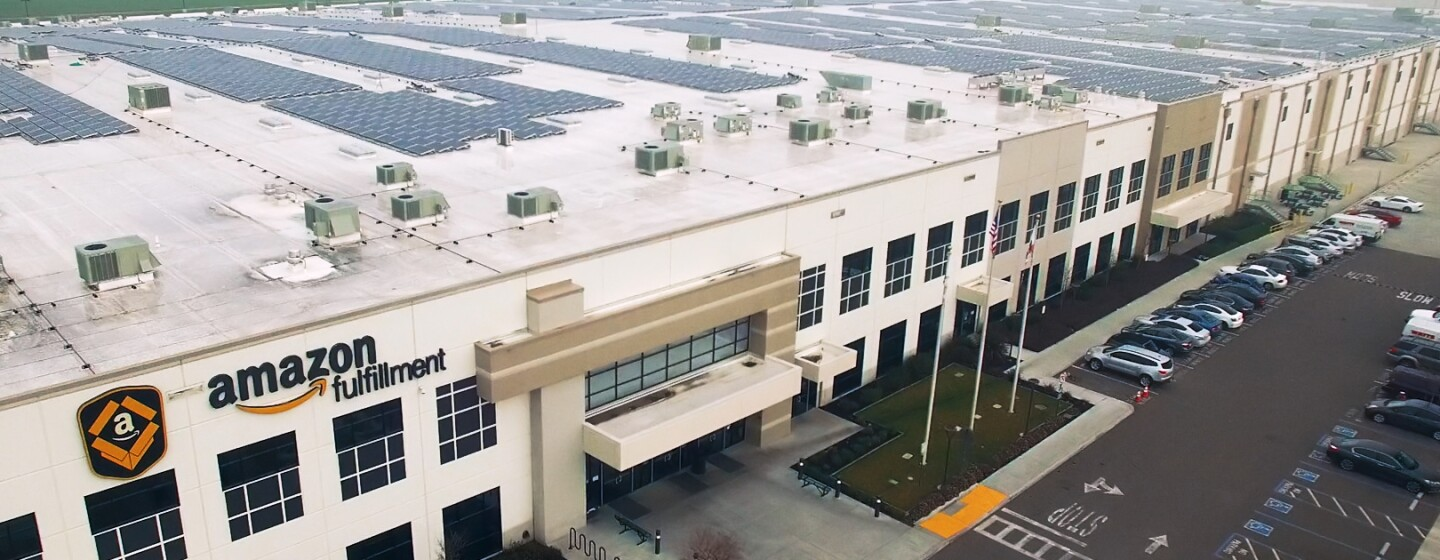 Solar panels atop an Amazon fulfillment center
