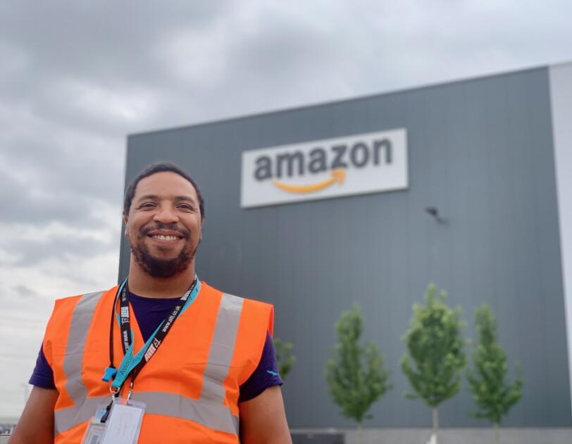 Noel McLean standing in front of an Amazon site