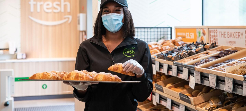 Inka Kouakou holding croissants in the Amazon Fresh bakery