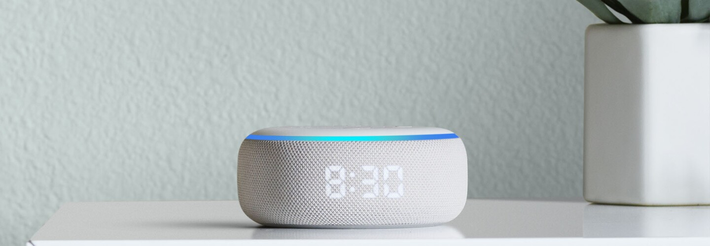 New Amazon Echo with clock on a bedside table