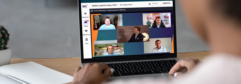 Eine Person, von hinten erkennbar, sitzt vor einem aufgeklappten Laptop. Auf dem Screen die Protagonisten der BVL Videokonferenz.