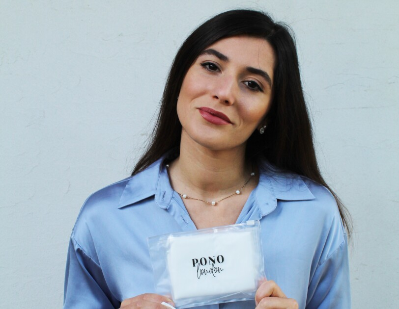 Mariana Santos, Founder of PONO London holding one of her products.