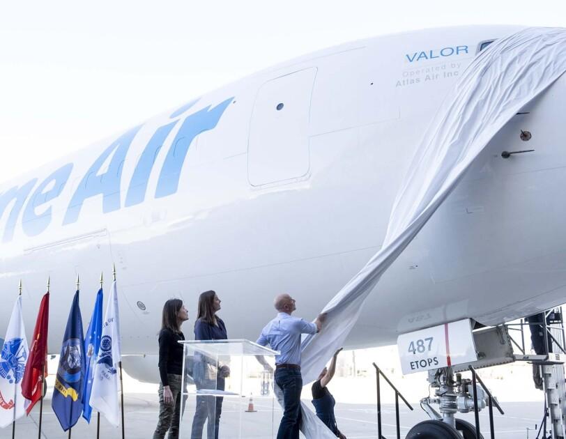 Jeff Bezos unveils unveils 40th Amazon Air plane, honoring the Amazon military community.