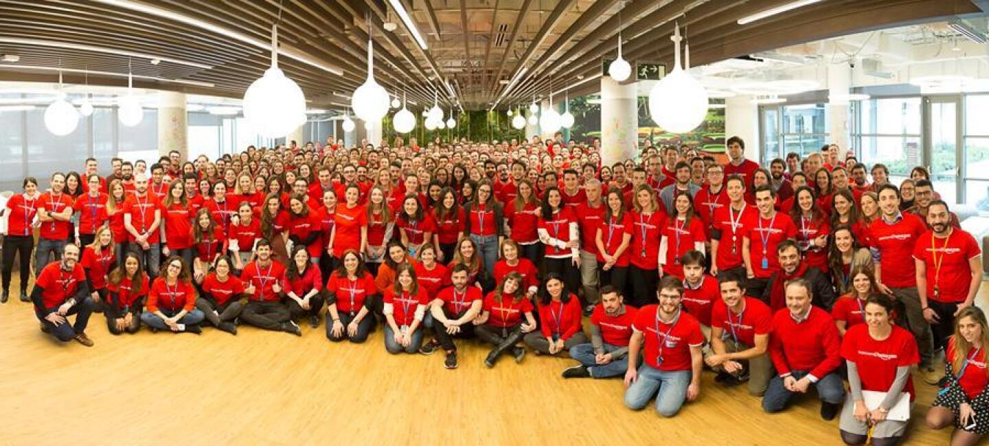 Amazon Spain team wearing red t-shirt for the International Women's Day.