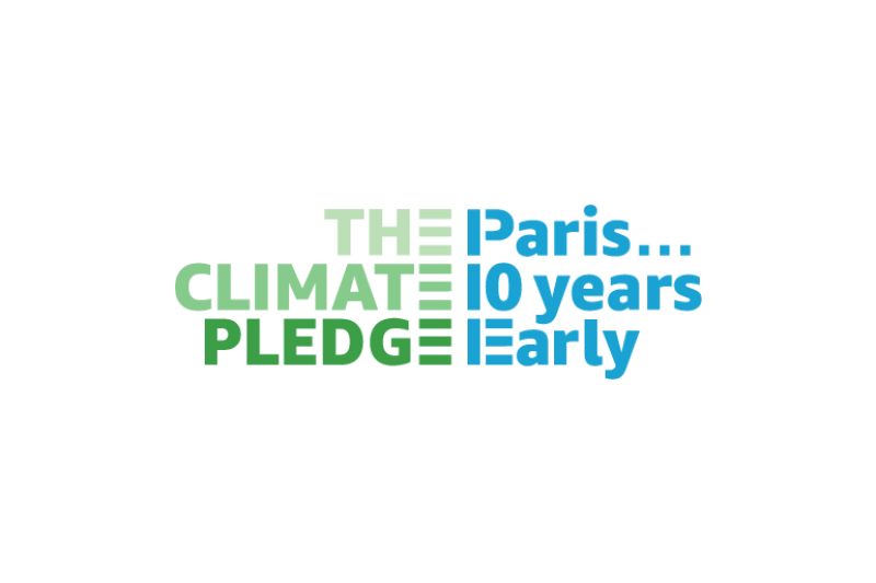 """Logo for The Climate Pledge says """"The Climate Pledge"""" in green """"Paris… 10 years early"""" in blue."""