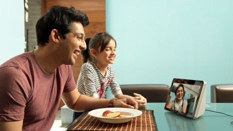 A man and a little girl (maybe father and daughter), speak to a lady (maybe the girl's mother), on an Echo show device
