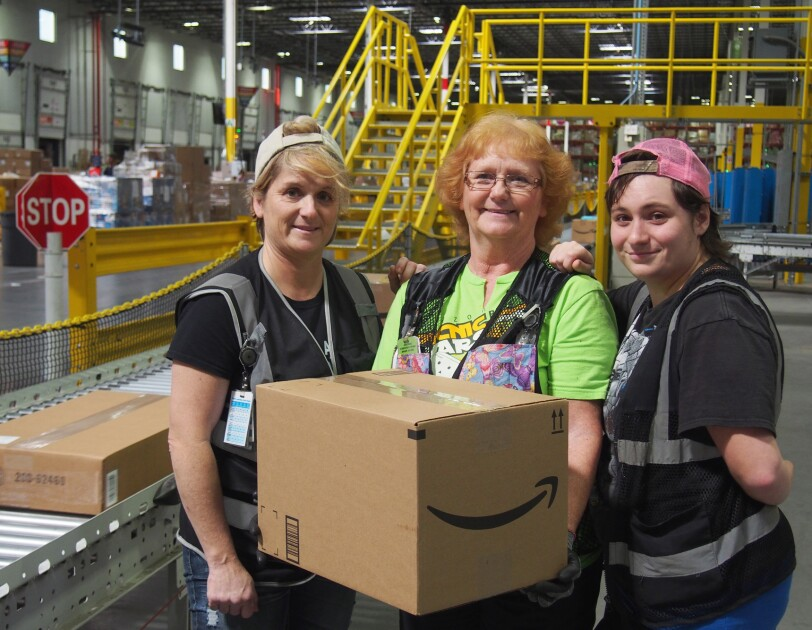 Amazon employees Amber Sells and Rita Stafford with Tori Smithers, who worked with her mom and grandmother at our Lebanon, Tennessee fulfillment center.
