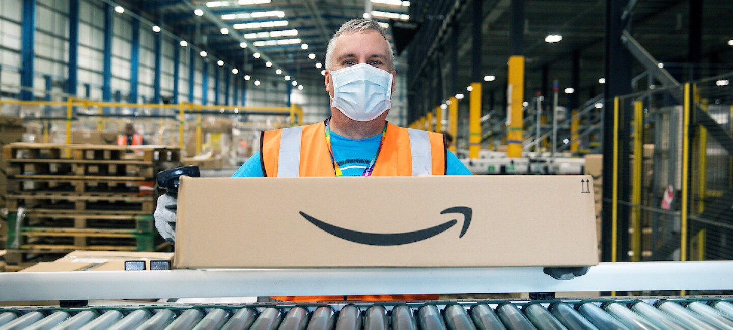 man holding box with Amazon smile and mask at Chesterfield Amazon