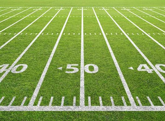yard lines painted on  football field turn