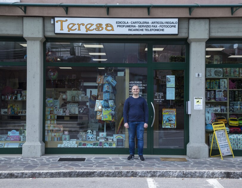 "Andrea Locatelli, standing in front of the local shop ""Teresa"""