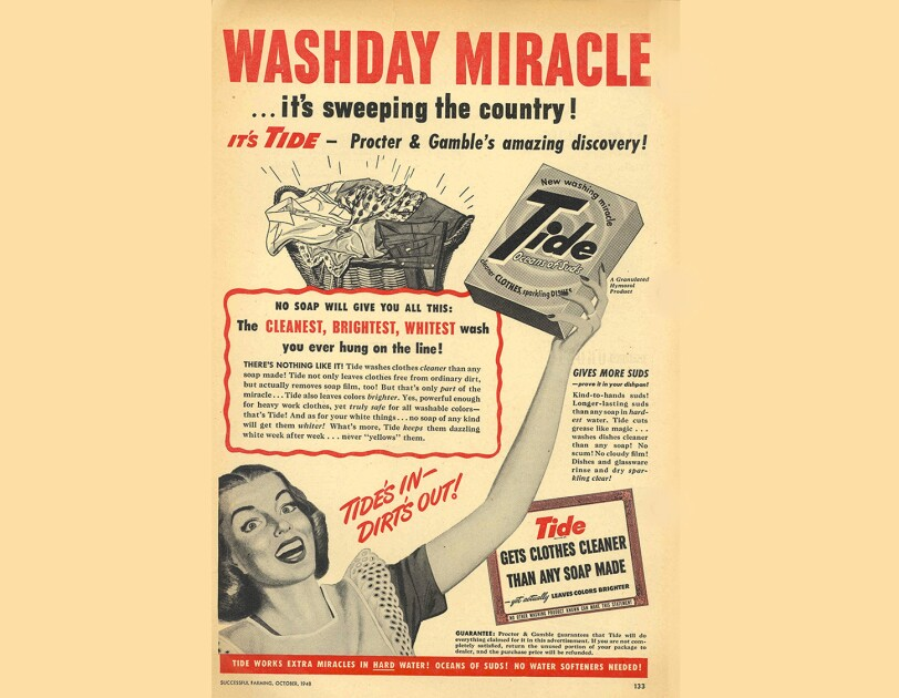 "Vintage print advertisement for Tide laundry detergent. The ad shows a woman holding a box of Tide aloft. The text at the top of the ad says ""washday miracle"" in all-capital letters."