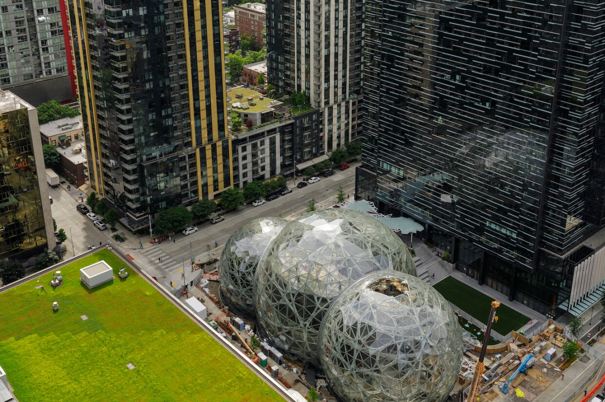 A photo of Amazon's Day One building and the construction of the Seattle Spheres.