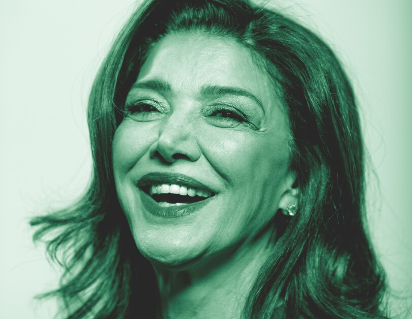 """Shohreh Aghdashloo, from the Amazon Originals series """"The Expanse"""" poses for a photo. The image has been treated with a green filter."""