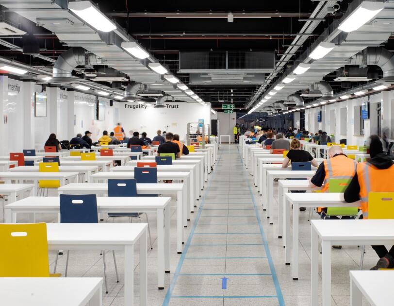 Amazon employees sat socially distanced