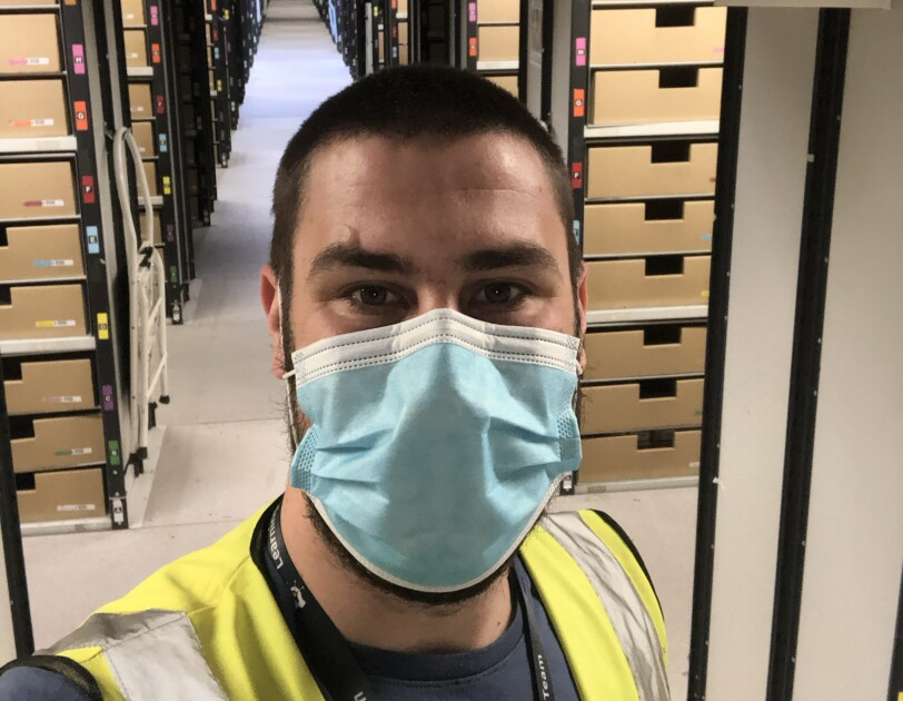 Amazon employee wearing a mask