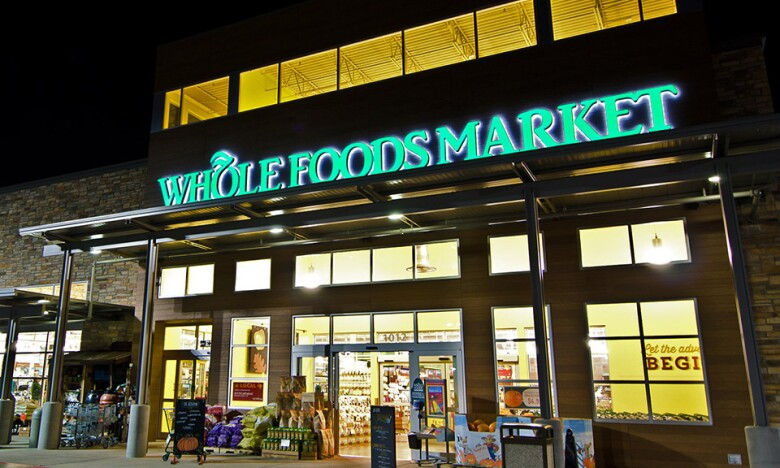 Social - Whole Foods storefront at night