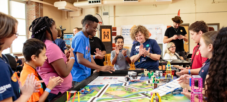 Students crowd around a STEM project at Metro Nashville Public Schools