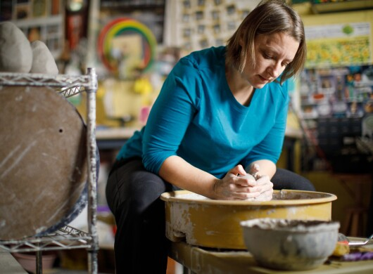 Sarah Bak, a Amazon Handmade seller, molds clay in her studio.