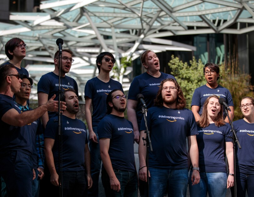 Members of Amazon's 'Vocally Self Critical' a cappella group perform a song that they will sing as part of the upcoming Opening Ceremony of the USA Games.