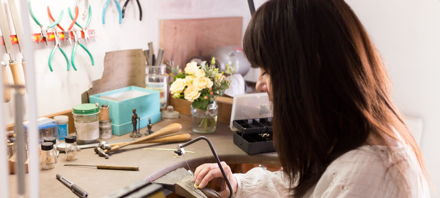 Female entrepreneur at work in her crafts studio