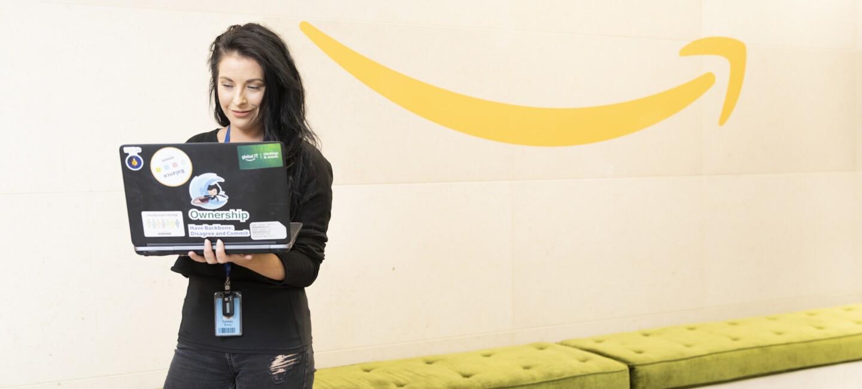 AWS female employee working on laptop