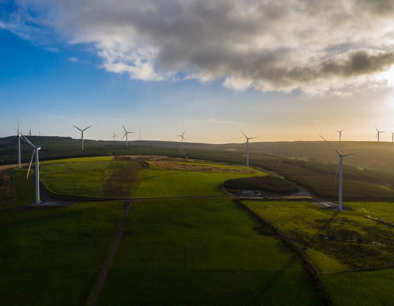 A wind energy farm in fields in Europe.