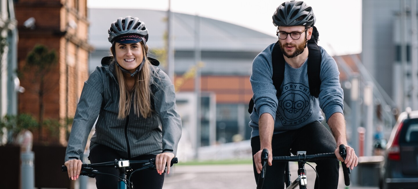 two cyclists riding in the city