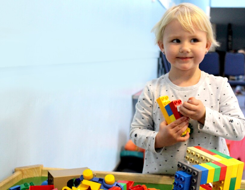 In Kind Direct charity image of child playing with lego