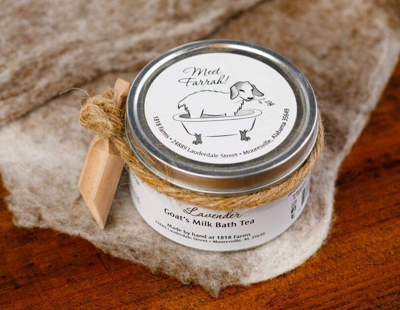 A jar of lavender goat's milk bath tea.