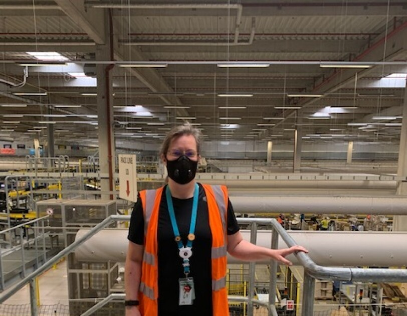 Morag Kitson, Associate at Amazon's fulfilment centre in Swansea, pictures standing on a mezzanine overlooking the shop-floor.