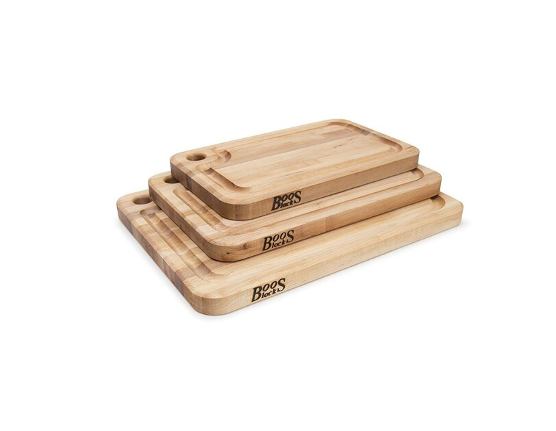 Stack of three Boos Block cutting boards on a white background