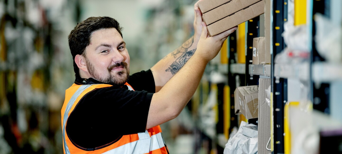 Andrew Kirkby, fulfilment centre employee at Amazon in Doncaster, pictured at work