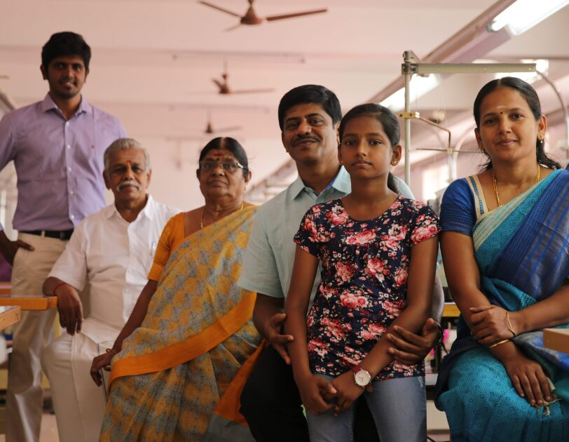Sivaraj of the Espresso brand of knitwear at his workplace and with his family