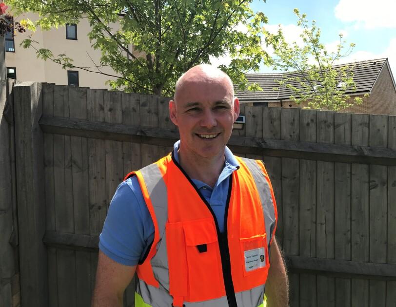 Headshot with PPE Darren Emmett