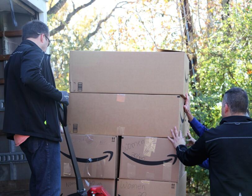 Amazon associates unload supplies for backpacks