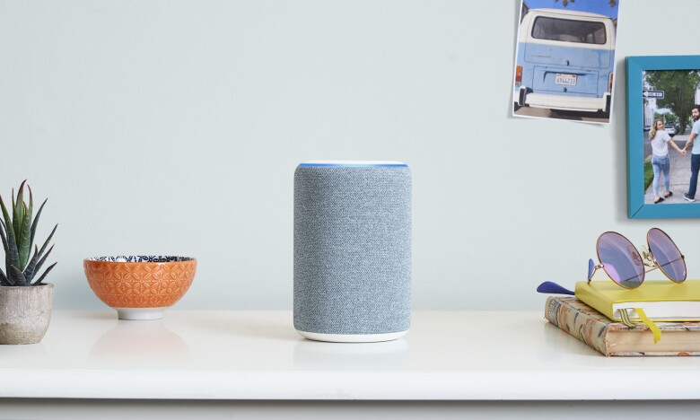 Alexa device sat on top of white desk