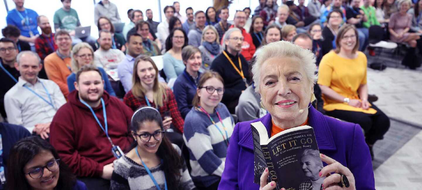 Dame Stephanie Shirley speaking at the Amazon Cambridge Development Centre