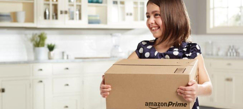 Girl holding Amazon Prime box