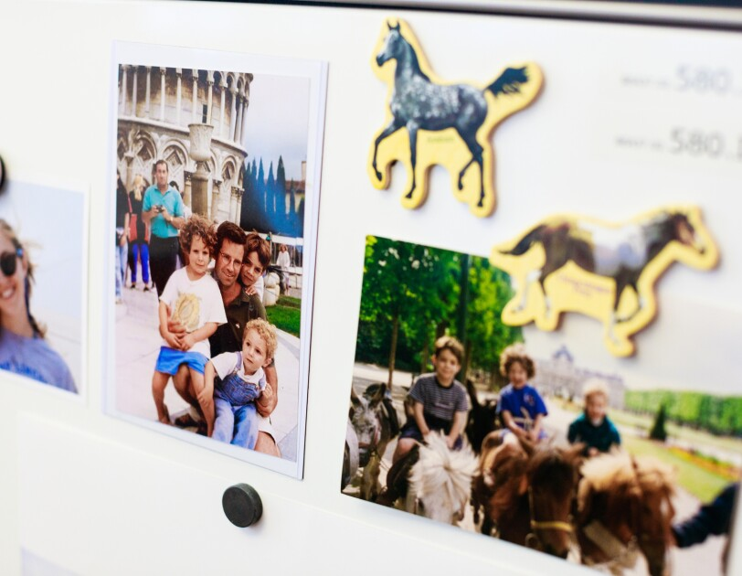 Family photos posted next to Therese Landefeld's desk at Amazon.