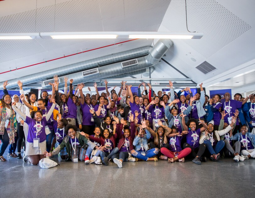 Group picture of young participants of the AWS Girls' Tech Day event.