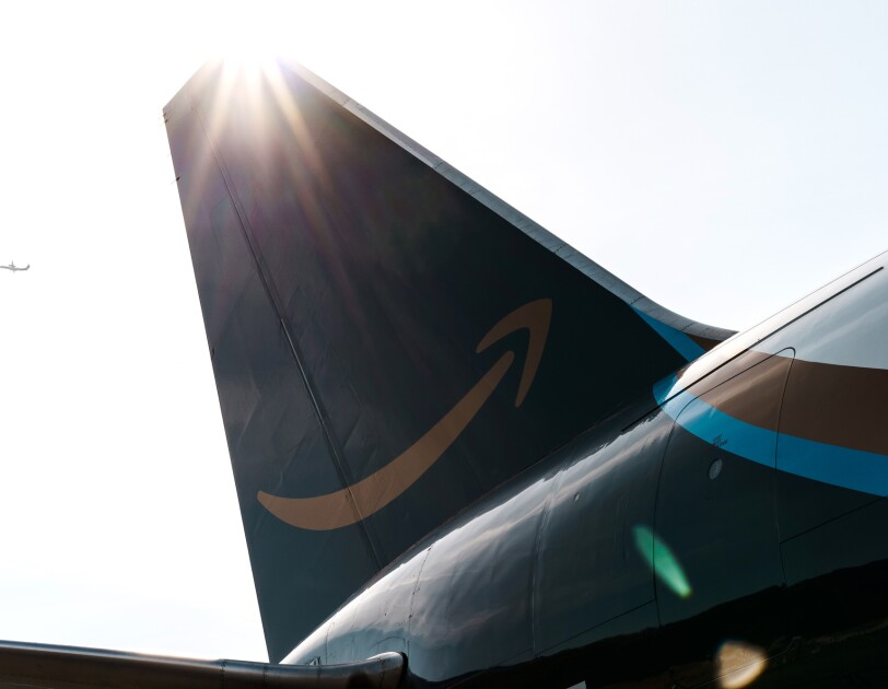 An aircraft tail  - in a dark gray, with a gold Amazon smile.