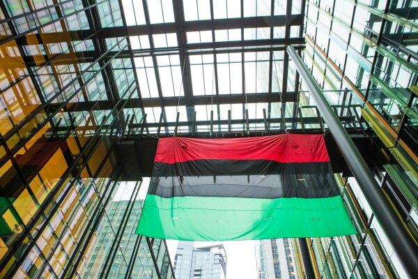 Black Employee Network Flag Raising at an Amazon Building