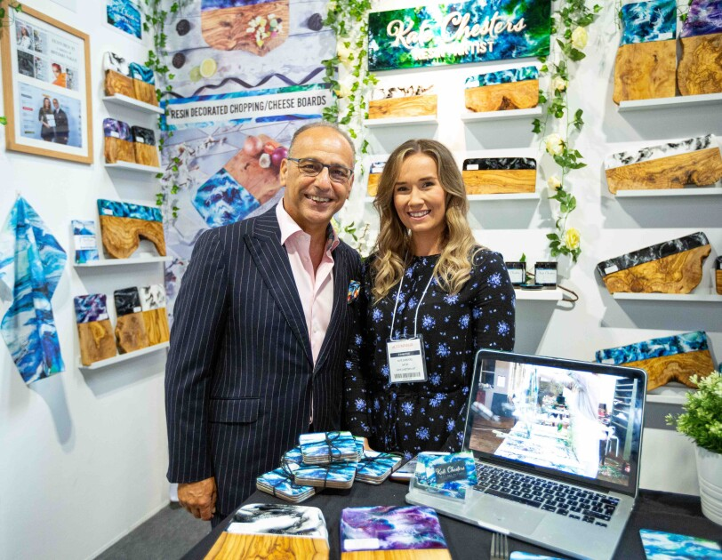 Kate Chesters and Theo Paphitis at her stand at the Autumn Fair, there are lots of Kate's products surrounding them.
