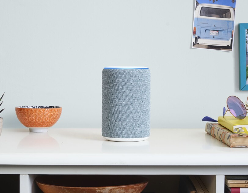 New Amazon Echo device in midnight blue on a console table.