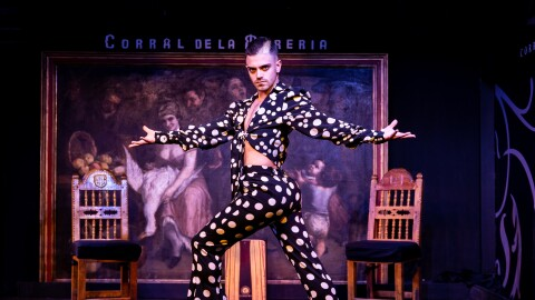 Rubén Heras Amazon Stars Spain winner holding a pose in a polka dot patterned suit
