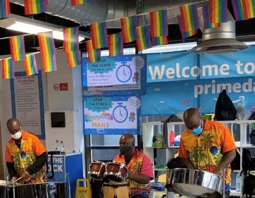three men in a Calypso Band at amazon fulfilment centre in Bolton