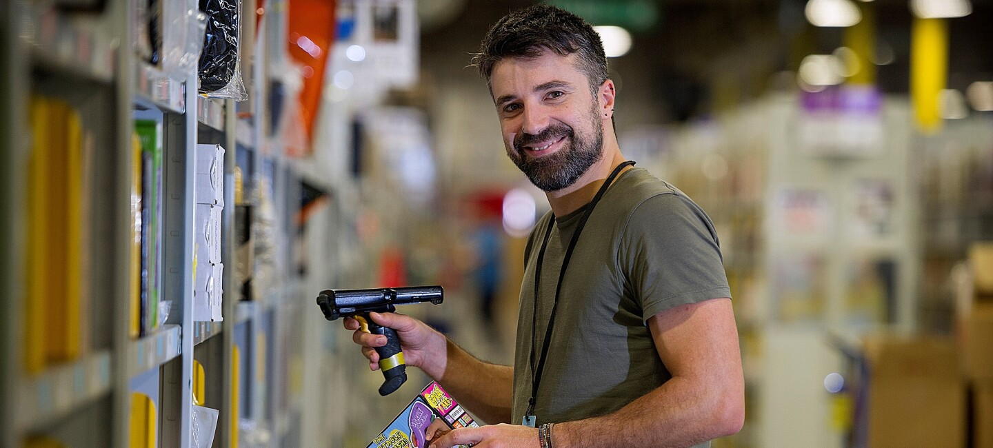 Fotis Karounias, fulfilment centre employee at Amazon in Gourock, pictured at work