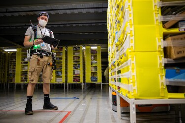 Amazon associate wears a mask while working. Photo taken during COVID-19 pandemic.